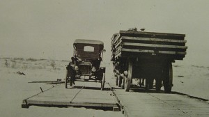 Photo of Ford on plank road -- the plank road was used to cross the sand dunes in the desert.