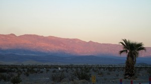 Sun setting on mountains in Death Valley
